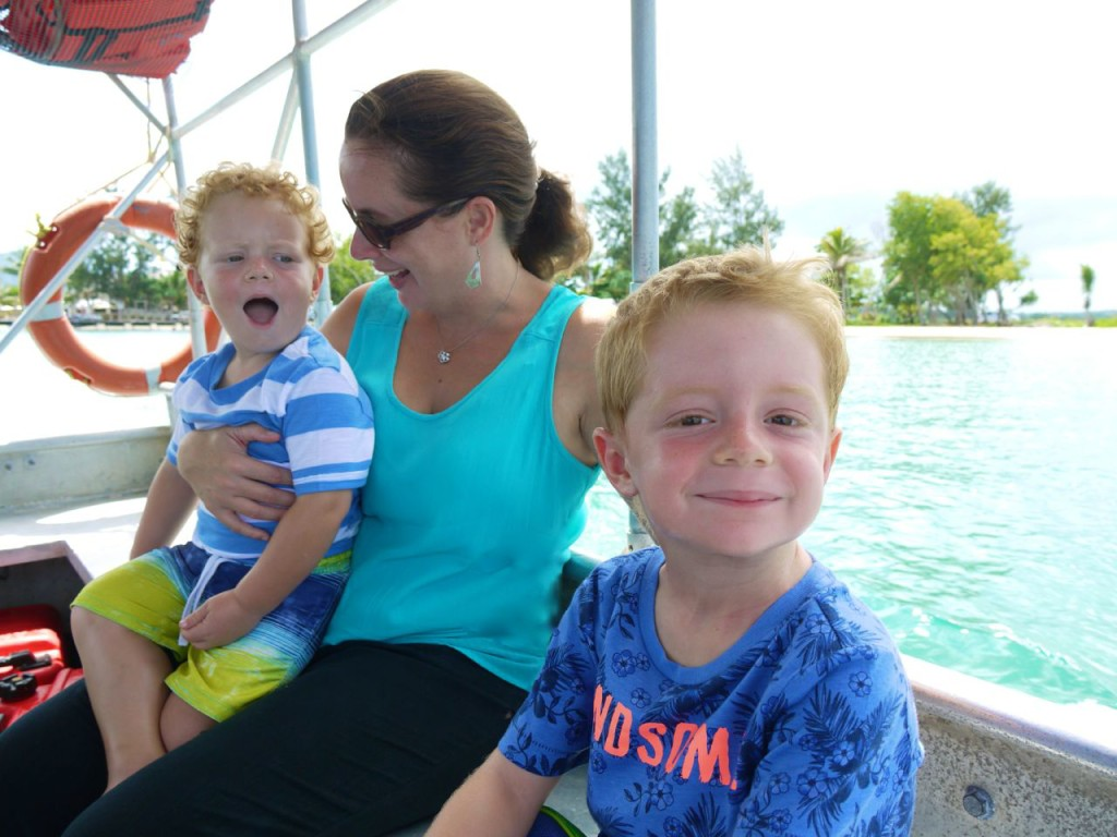 Lisa and boys on boat Hideaway